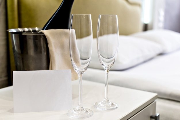 Honeymoon concept. champagne bucket near bed in a hotel room