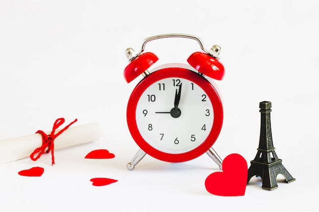 Honeymoon. invitation to a romantic trip, a love note. eiffel tower with red alarm clock