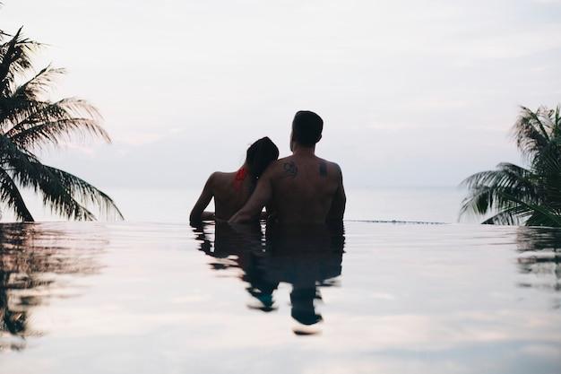 Honeymooners watching the sunset