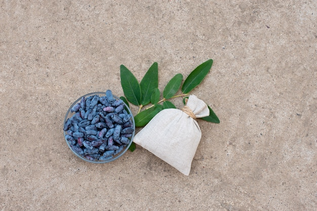 Honeysuckle berries on a bowl and linen bag