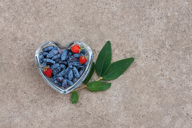 Honeysuckle berries on a heart-shaped bowl