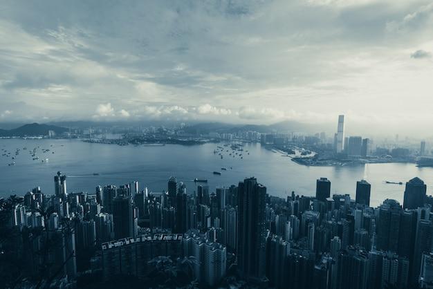 Hong kong - april 25, 2020: panorama of victoria harbor of hong kong city, cityscape with skyscraper