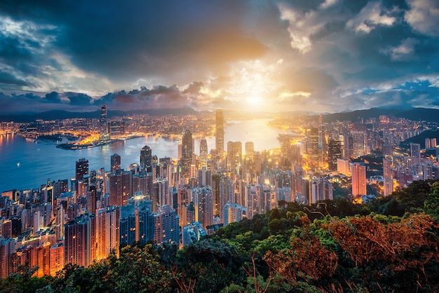 Hong kong city skyline at sunrise view from peak mountain.