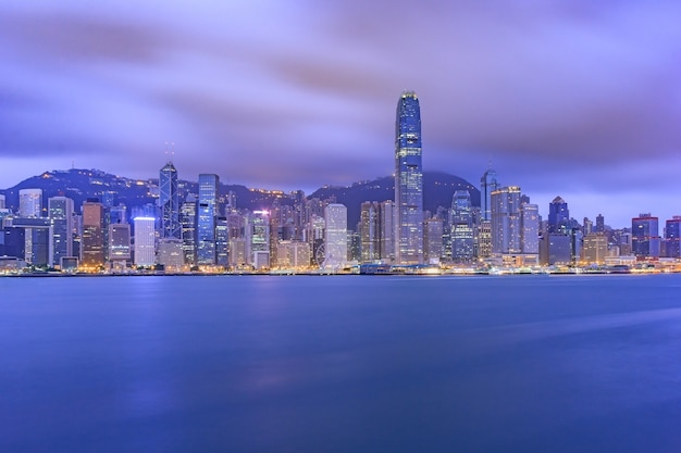 Hong kong city skyline at sunset and twilight, panorama view kowloon public pier