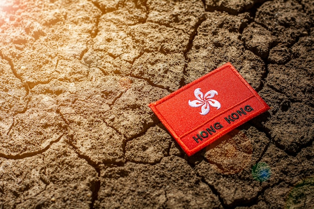 Hong kong flag on abandoned cracked ground.