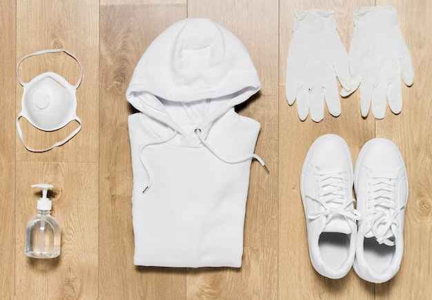 Hoodie with shoes and gloves beside
