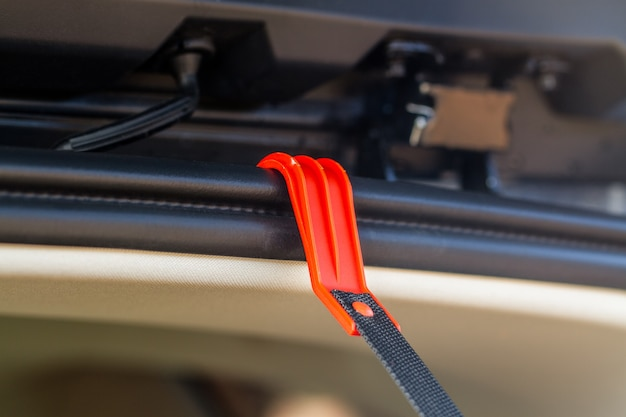 The hook for helping driver inside car trunk.