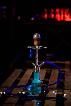 Hookah on the background of a bar, light, smoke, smog