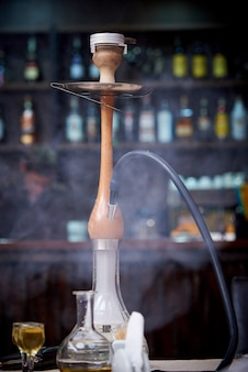Hookah on a blurred bar