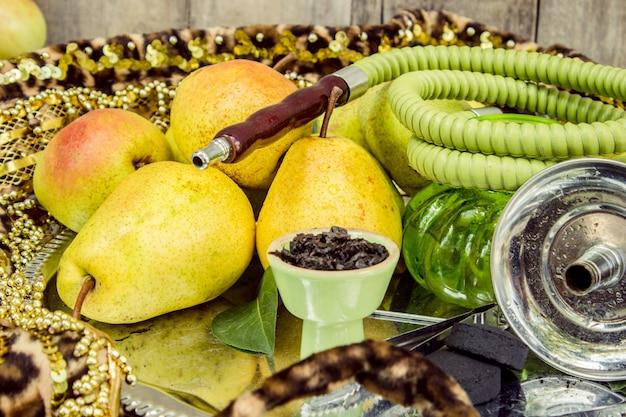 Hookah. tobacco flavor of pear. food nature.