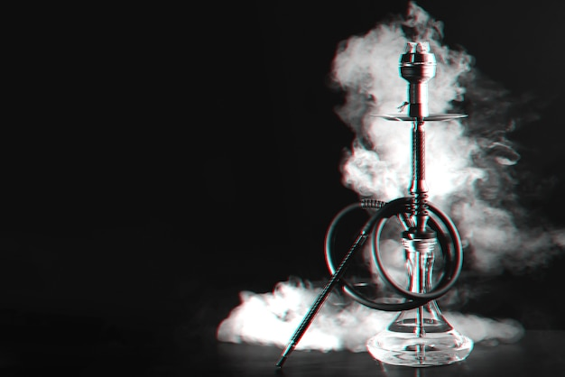 Hookah with coals and smoke on a table