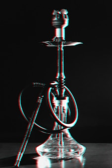 Hookah with a glass flask on a table