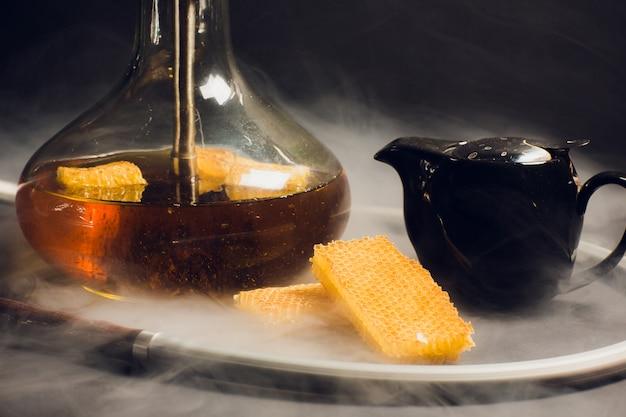 A hookah with a honey base, a sweet taste of hookah, next to honeycomb honeycombs