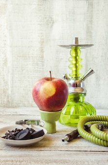 Hookah on a wooden background. tobacco fruit. selective focus.
