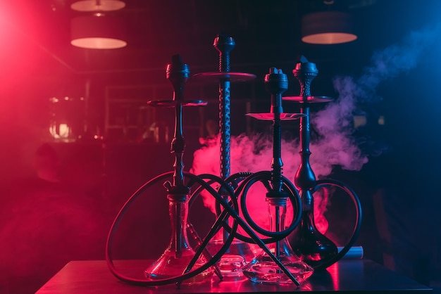 Hookahs with shisha bowls and coals in the restaurant for relaxation with tobacco use