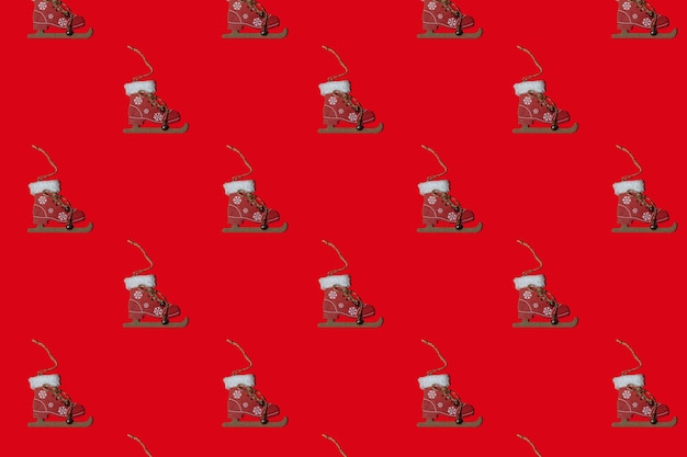 Horizontal christmas patern toy on a christmas tree on a red background. new year concept. minimalism