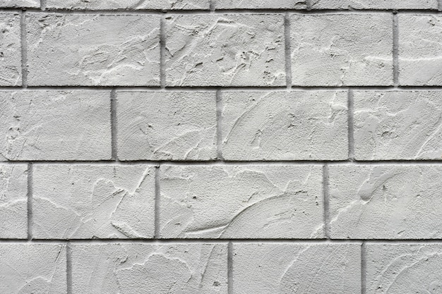 Horizontal concrete wall textured background. white grey rustic color.  grungy shabby uneven painted plaster.