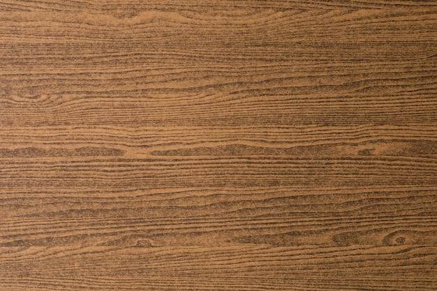 テキストのためのコピースペースを持つ水平の濃い茶色の木目の穀物のテクスチャ