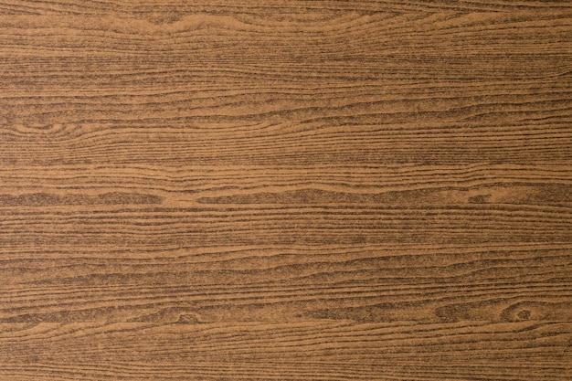 Horizontal dark brown wooden grain texture with copy space for text de