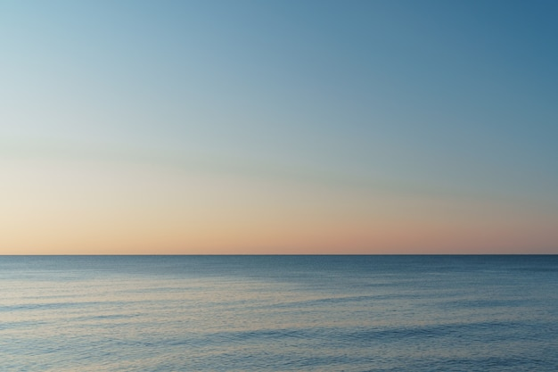 Horizontal line between sea and sky at sunset. static minimalistic composition
