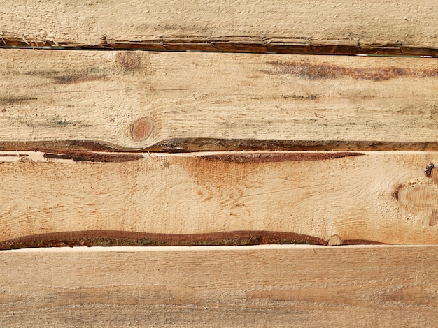 Horizontal lumber. lumber from pine boards. roughly processed pine board. lumber texture. gap in the boards.