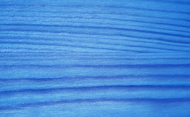 Горизонтальный узор лазурно-синего градиента окрашенной поверхности деревянной доски