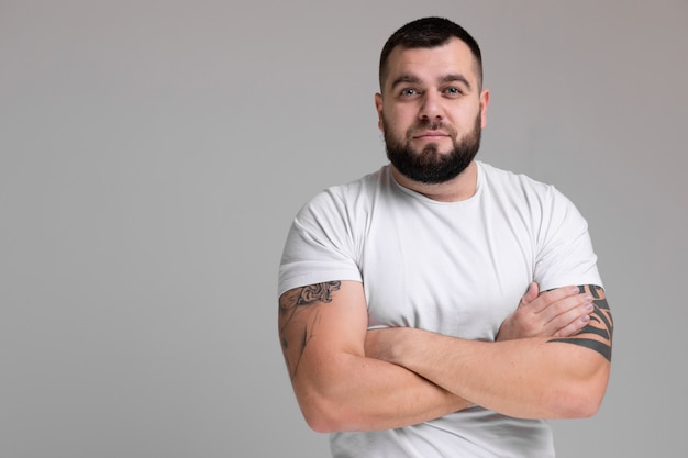 Horizontal portrait of strong man isolated on light