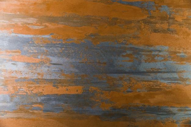 Horizontal rust marks on metallic surface