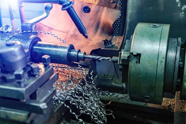 Horizontal shot of a lathe grinding machine indoors.