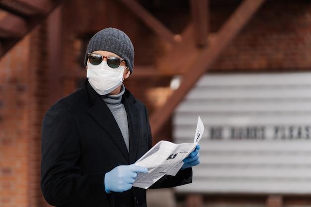 Horizontal shot of man uses virus preventive measures during coronavirus pandemic