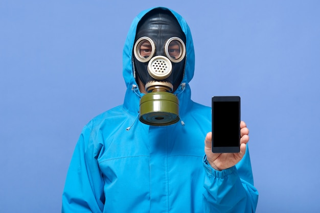 Horizontal shot of man wearing gas mask and uniform