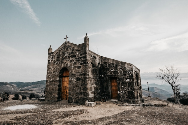 Horizontal shot of an old small church on a mountain