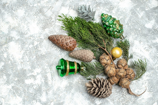 Horizontal view of conifer cones and decoration accessories lying on white background