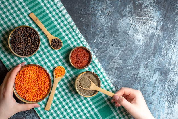 Horizontal view of dinner preparation with different spices yellow pea on green stripped towel