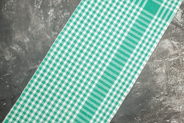 Horizontal view of green striped towel on gray table