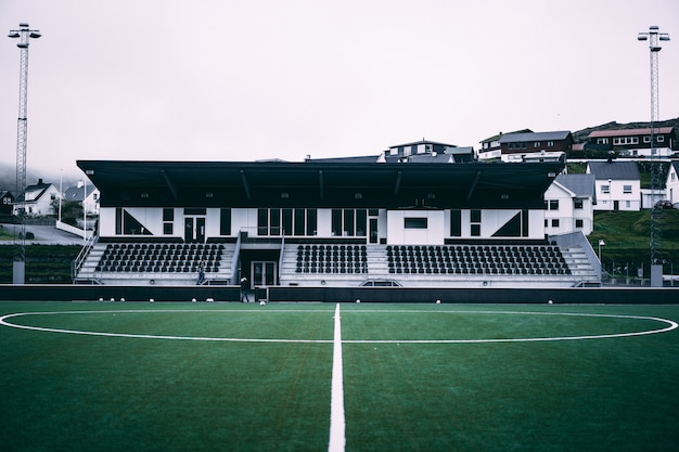Horizontal view of little football stadium on the faroe islands.