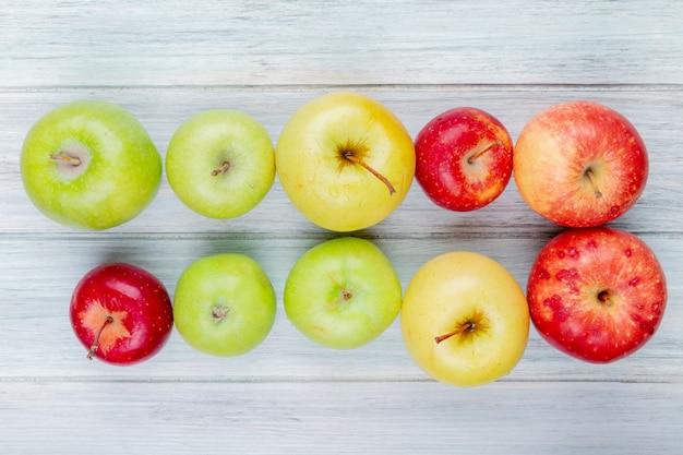 木製の背景にリンゴのパターンの水平方向のビュー