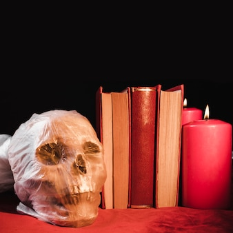 Horror concept with skull andtomes