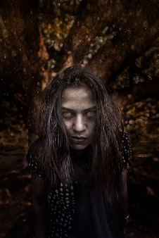 Horror scene of a possessed woman black long hair ghost halloween concept