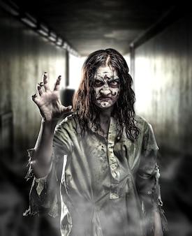 Horror zombie in a dark corridor.