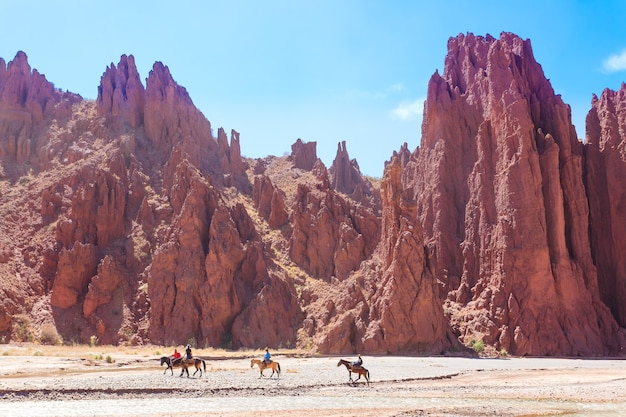 Horse riders crossing river from duende canyon,bolivia.outdoor activity.bolivian nature