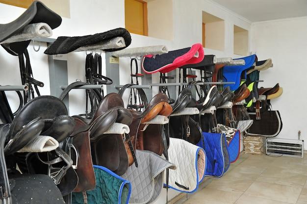 Horse saddles on stock.
