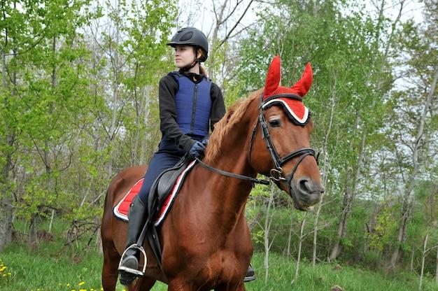 Horseback riding on a green meadow