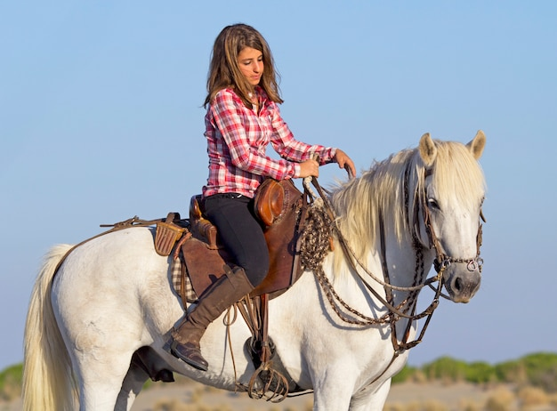 Horsewoman on the beach