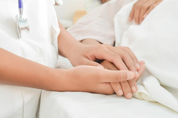 Hospital patient hands to care