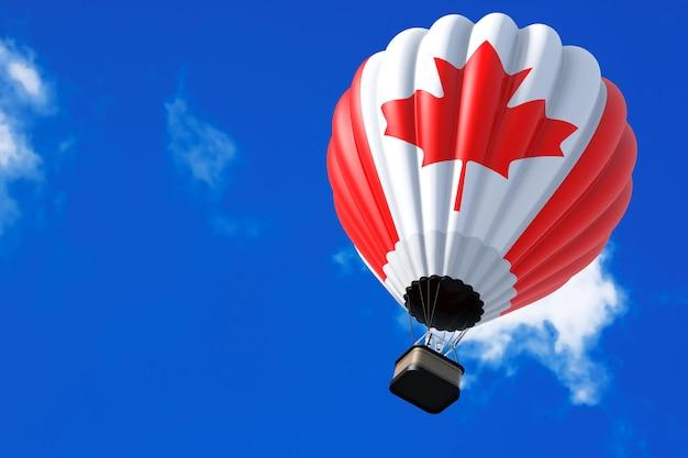 空の背景に飛行中のカナダの旗としての熱気球