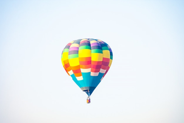 Hot air balloon over the green paddy field. composition of nature and white background.