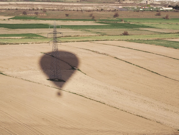 Hot air balloon shadow flying over the landscape at cappadocia