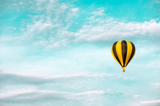 Hot air balloon in summer blue sky with copy space. the concept of delivery of goods by air
