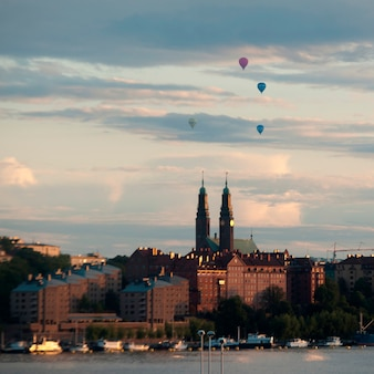 Hot air balloons over a city, stockholm, sweden